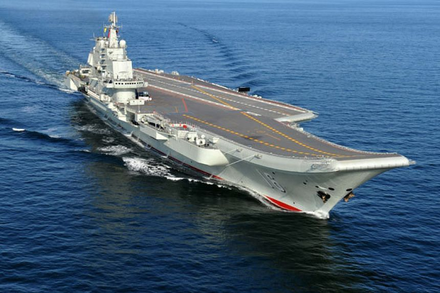 China is reportedly building another aircraft carrier after satellite imagery showed a military hull being built at a dry dock in Dalian associated with its sole carrier Liaoning (pictured).