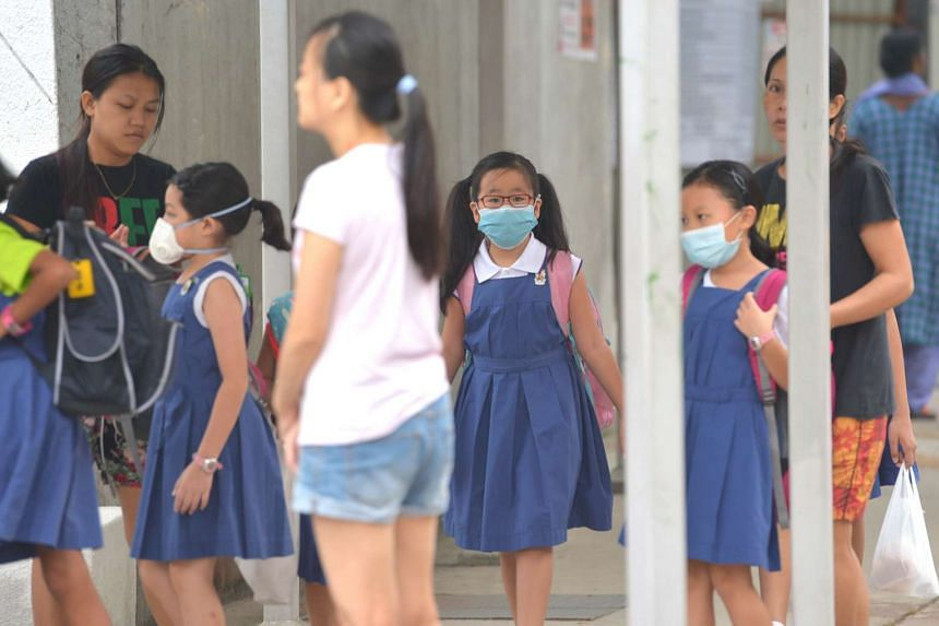 CHIJ Toa Payoh pupils wearing masks as they head to school at 7.30am on Thursday (Oct 1).