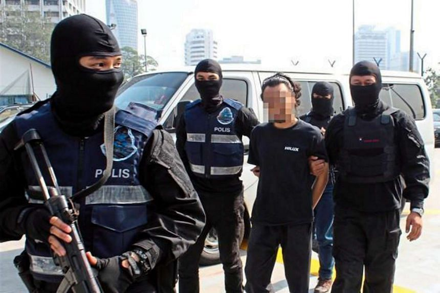 A suspected ISIS member detained by the Malaysian police for allegedly planning a series of terror attacks in Klang Valley. This photo was released in July 2015.