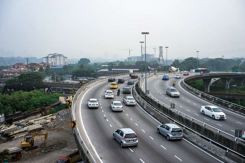 Motorists travelling along a highway shrouded in haze in Kuala Lumpur on Sept 29, 2015.