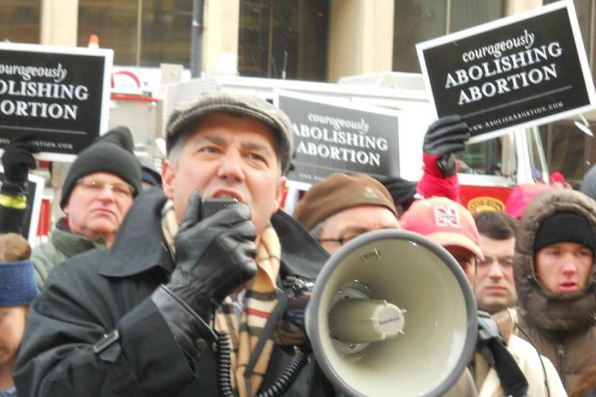 Troy Newman, a anti-abortion campaigner, was detained at Melbourne Airport after landing on a flight from the United States, a spokeswoman for Australian minister for Immigration Petter Dutton said.