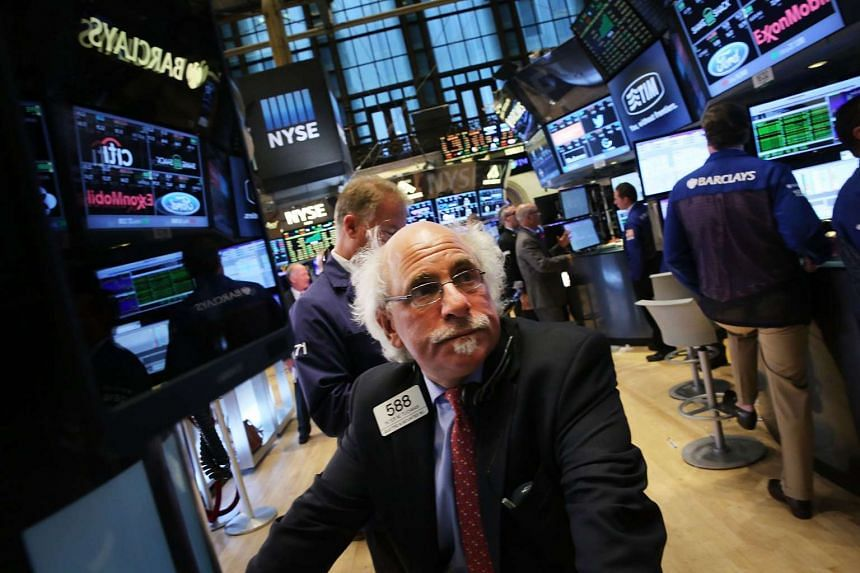 A trader work on the floor of the New York Stock Exchange on Sept 15, 2015 in New York City.