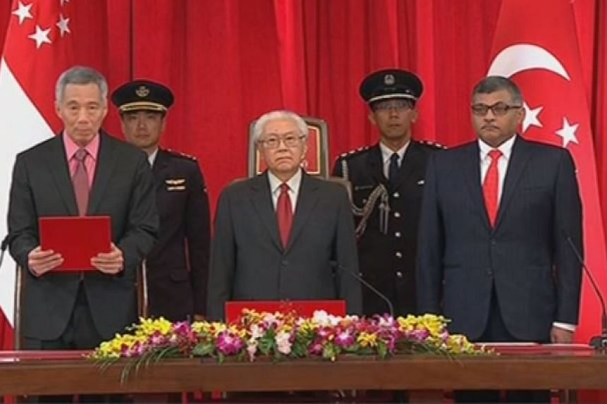 PM Lee Hsien Loong, President Tony Tan and Chief Justice Sundaresh Menon at the swearing-in ceremony.