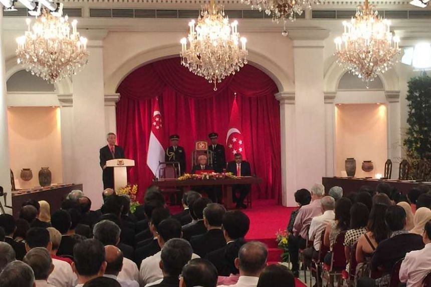 PM Lee Hsien Loong speaking during the swearing-in ceremony at the Istana.