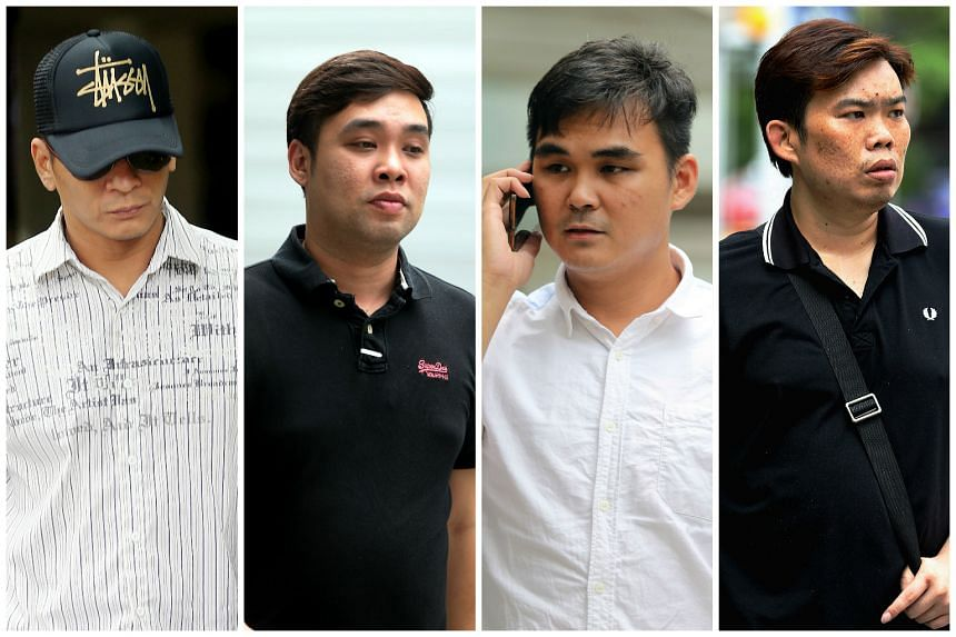 Salesmen (from left) Koh Guan Seng, Kam Kok Keong, Lim Hong Ching and Kelvin Lim Zhi Wei have pleaded guilty to conspiring to cheat customers at Mobile Air.