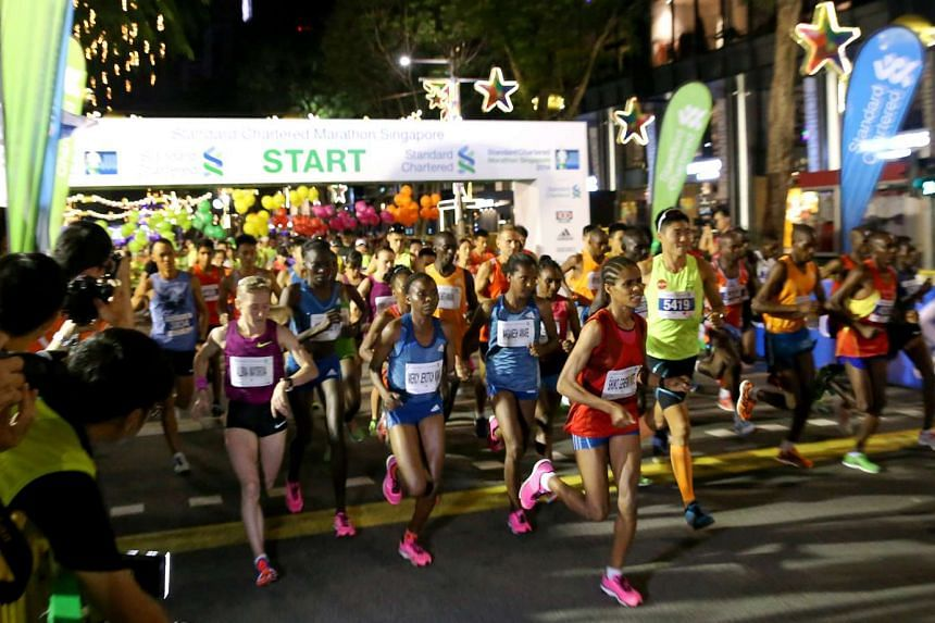 Participants at the flag-off point of the Standard Chartered Marathon Singapore (SCMS) in Orchard Road on 7 December 2014. the 2015 SCMS will take place over two day for the first time in its 14-year history.
