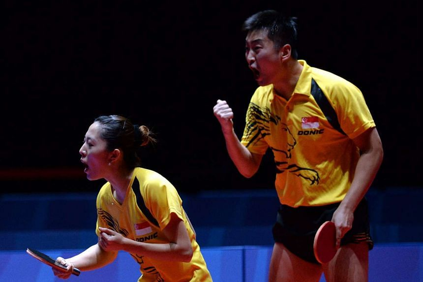 Singapore's Yang Zi (right) and Yu Mengyu react in the table tennis mixed doubles at the 28th SEA Games competition on Jun 3, 2015.