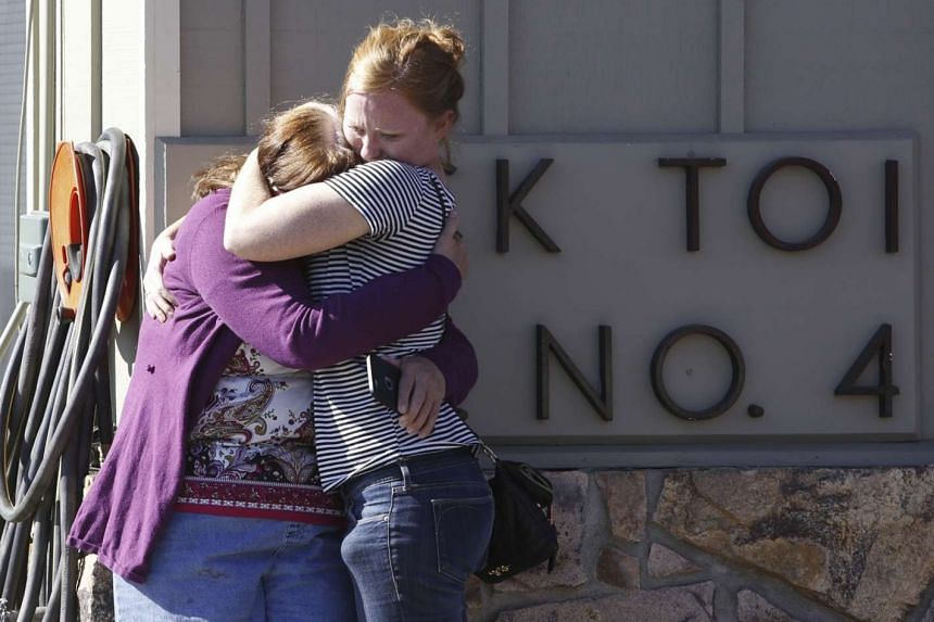 Umpqua Community College alumnus Donice Smith (left) said one of her former teachers was shot dead, near the site of a mass shooting at Umpqua Community College in Roseburg, Oregon, on Oct 1, 2015.