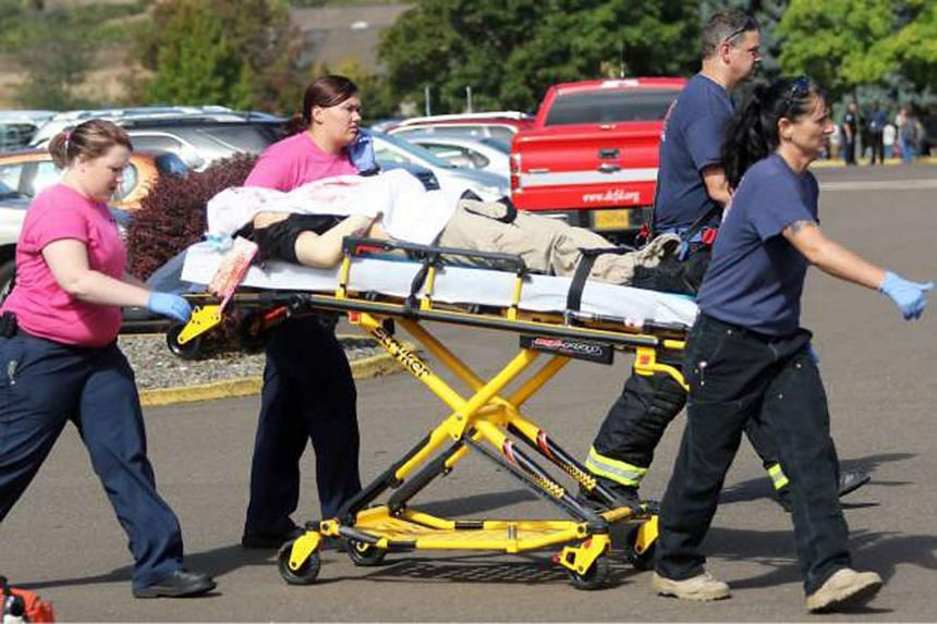 First responders transporting an injured person following a shooting incident at Umpqua Community College in Roseburg, Oregon on Oct 1, 2015.