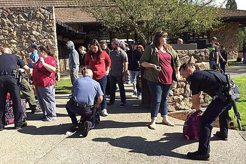 Police officers searching students outside Umpqua Community College in Roseburg, Oregon, after a shooting on Oct 1, 2015.