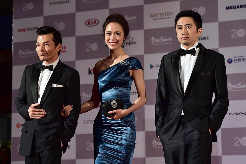 (From left) Vietnam actor Bao Son Tran, actress Ngoc Anh Vu and actor David Tran posing on the red carpet for the opening ceremony of the Busan International Film Festival (BIFF) on Oct 1, 2015.
