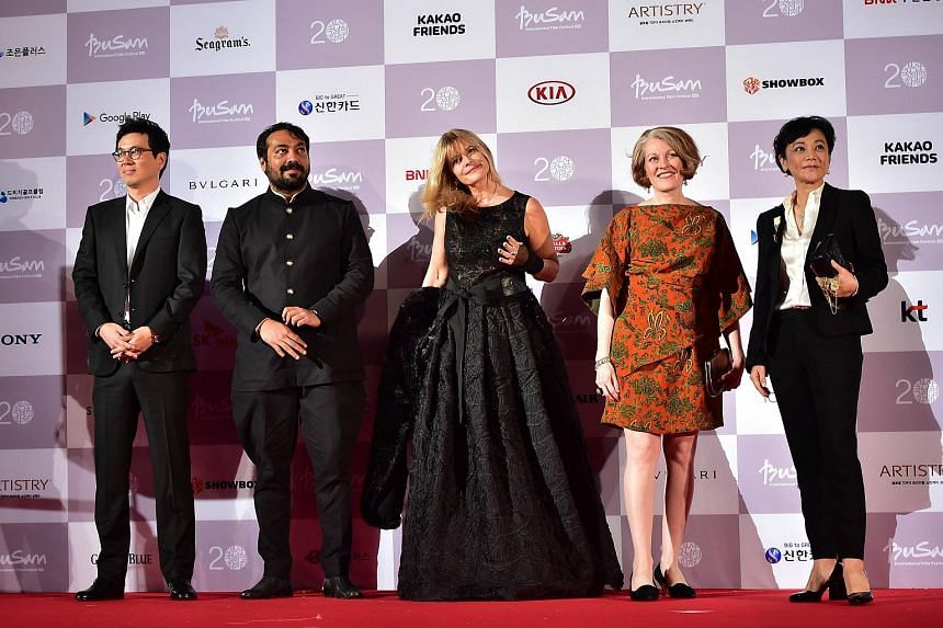 South Korean director Kim Tae Yong, Indian director Anurag Kashyap, German actress Nastassja Kinski, US film critic Stephanie Zacharek and Taiwanese director Sylvia Chang posing on the red carpet for the opening ceremony of the 20th Busan Internation