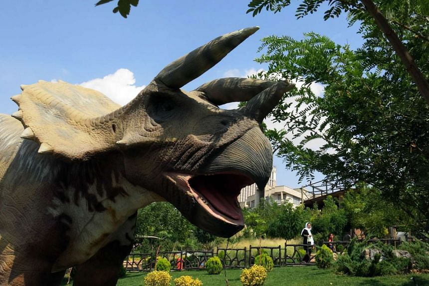 A dinosaur replica is seen at Tehran's Jurassic park in the western neighbourhood of Saadat Abad on Sept 10, 2015.