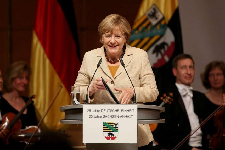 German Chancellor Angela Merkel speaking at a ceremony to mark 25 years of German unity and 25 years of Saxony-Anhalt in Halle/Saale, Germany on Oct 1, 2015.