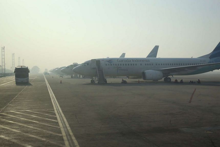 Thick haze fills the air at Syamsudin Noor Airport in Banjarmasin on Oct 2, 2015.