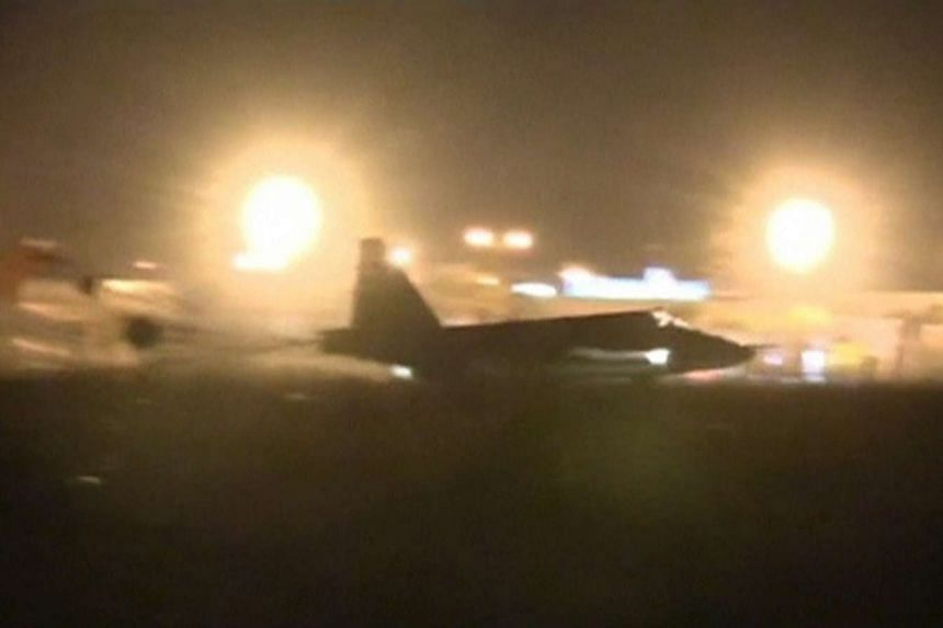 A frame grab taken from footage released Oct 1, 2015, shows a Russian military jet taxiing on runway shortly after the landing in Syria. Russia estimates its air strike campaign in Syria could last three to four months, the head of the foreign affai
