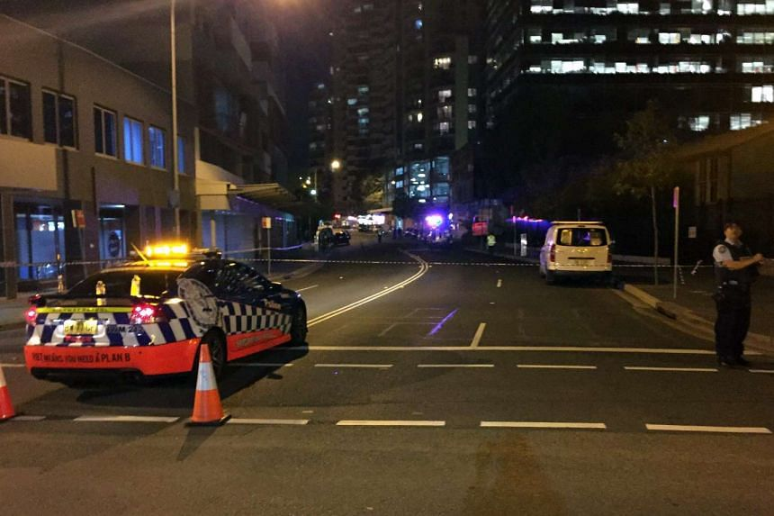 A police vehicle is seen at a cordoned-off street as a police officer secures the area after a shooting that left two dead in Parramatta, a suburb in the metropolitan area of Sydney, Australia, on Oct 2, 2015. A gunman shot and killed a civilian poli
