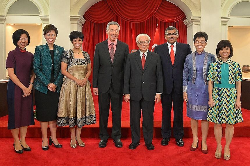 (From left) Ms Sim Ann, Mrs Josephine Teo, Ms Indranee Rajah, PM Lee Hsien Loong, President Tony Tan, Chief Justice Sundaresh Menon, Ms Grace Fu and Dr Amy Khor after the swearing-in ceremony yesterday.