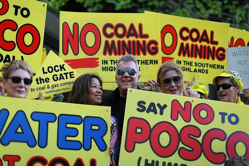 Rock singer Jimmy Barnes (centre) and Southern Highlands residents protesting in Sydney yesterday against a proposed coal mine in Sutton Forest. Canberra plans to make it harder for green groups to launch legal challenges.