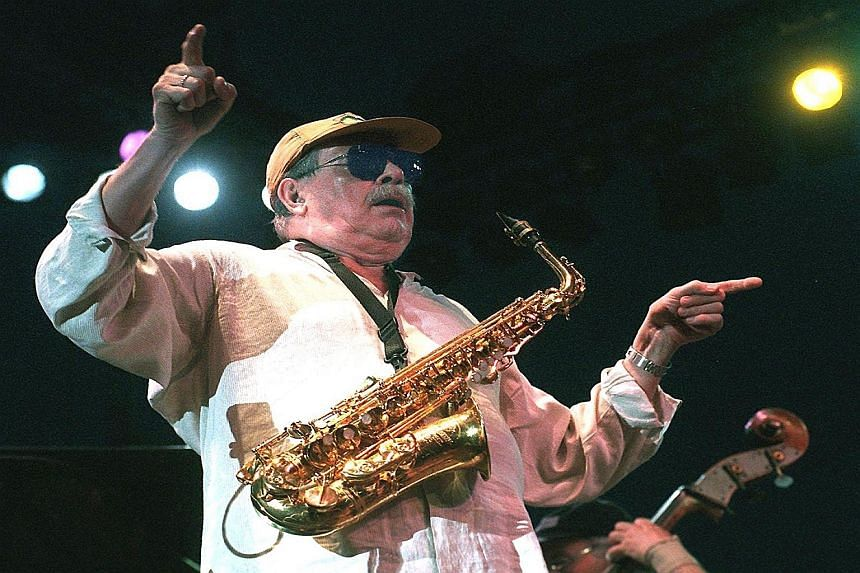 Jazz musician Phil Woods (left, performing in 1998) died on Tuesday from complications of emphysema.
