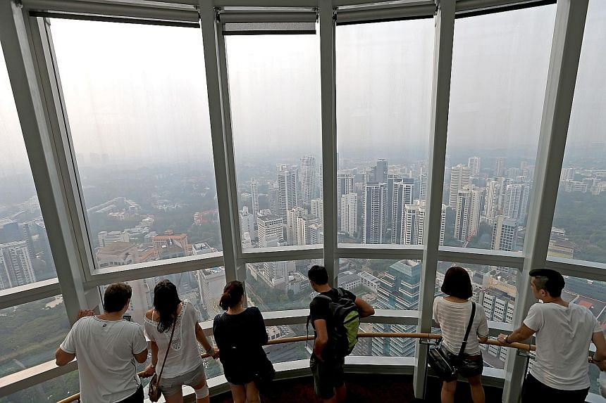 The view of the city from the Ion Sky observation deck. Overseas buyers traditionally add to demand for more expensive homes, including those in the central region and city fringes but their share of purchases has been on the decline.