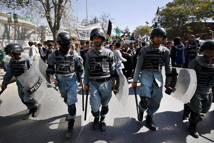Members of the Afghan security forces at an anti-Taleban protest in Kabul, Afghanistan, yesterday. According to a ministry statement, 150 Taleban had been killed and 90 wounded in the overnight offensive to retake the city of Kunduz.