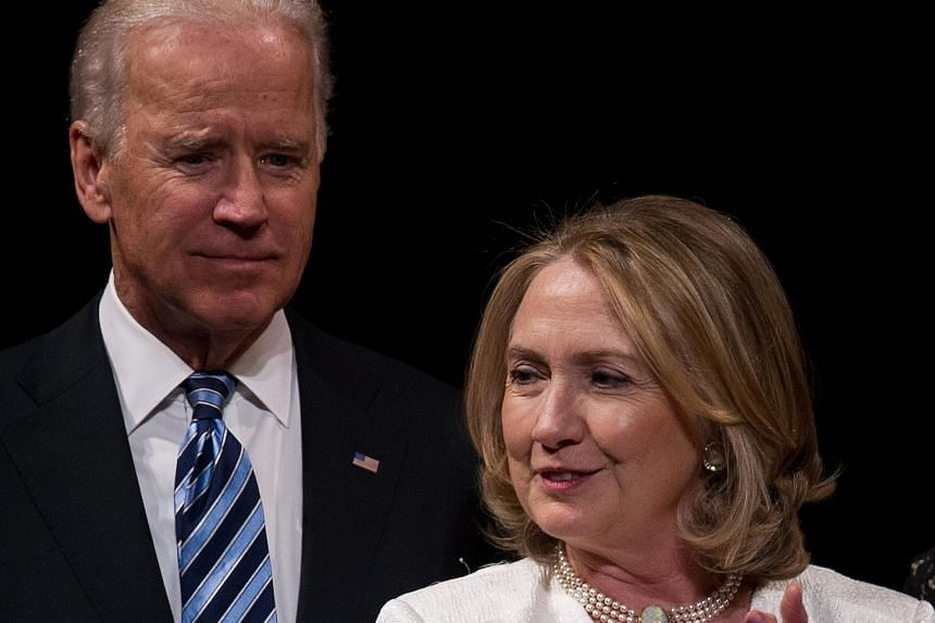 Mrs Hillary Clinton and Mr Joe Biden at an event in 2013 in Washington. Mrs Clinton's campaign is viewing the Vice-President's entry into the presidential race as a serious possibility.