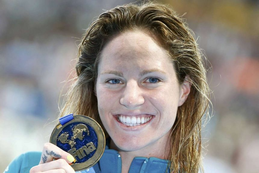 Emily Seebohm poses with gold medal after winning women's 200m backstroke final at the Aquatics World Championships in Kazan