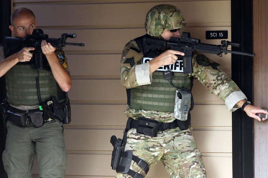 Police officers searching Umpqua Community College in after a shooting on Oct 1, 2015.