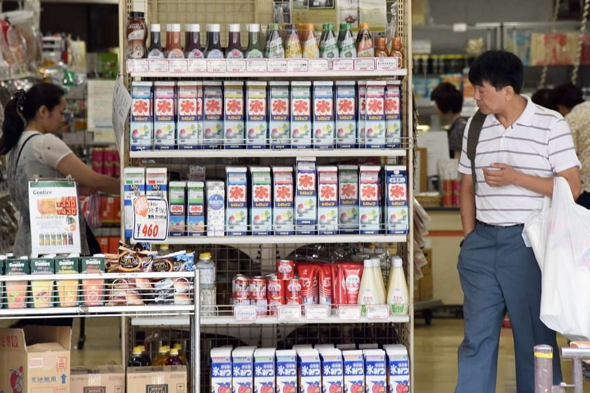 Shoppers at a supermarket in Tokyo.