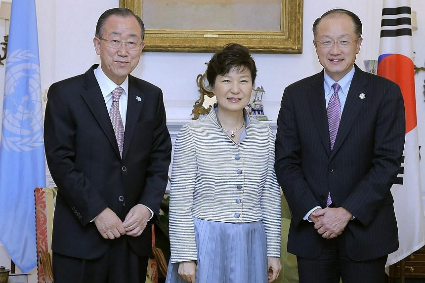 South Korean President Park Geun Hye (C)  with UN Secretary-General Ban Ki Moon (left) and World Bank President Jim Yong Kim ahead of their talks at Mr Ban's residence in New York on  Sept 25,  2015.