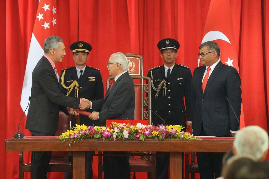 PM Lee Hsien Loong, President Tony Tan and Chief Justice Sundaresh Menon during the swearing-in ceremony at the Istana on Oct 1, 2015.