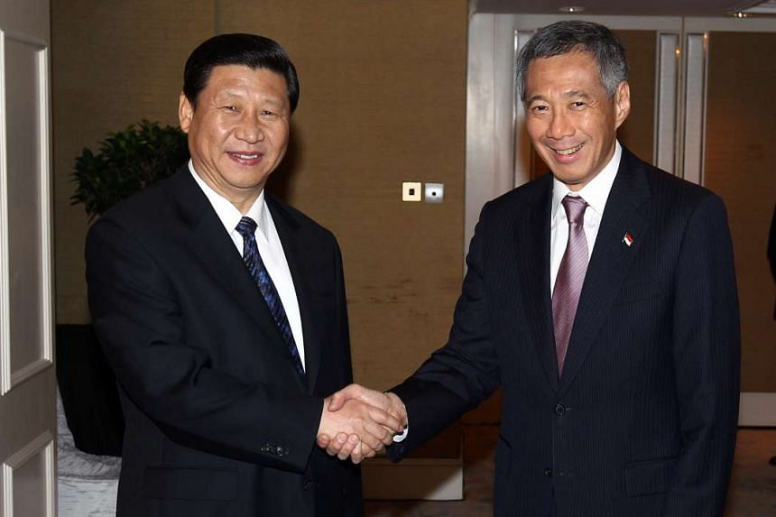 Mr Xi (left) and PM Lee in November 2010. Oct 3 will mark 25 years of diplomatic ties between Singapore and China.
