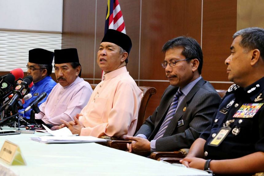 Datuk Seri Ahmad Zahid Hamidi (third from left) at his first press conference as Deputy Prime Minister on Jul 31, 2015.
