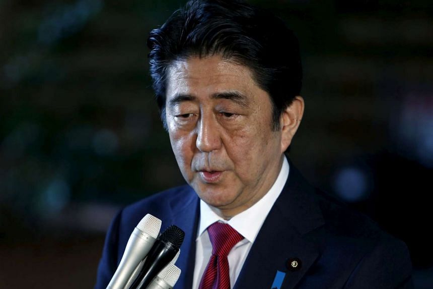 A new slogan adopted by Prime Minister Shinzo Abe is raising eyebrows among those who see it as an eerie echo of wartime propaganda.