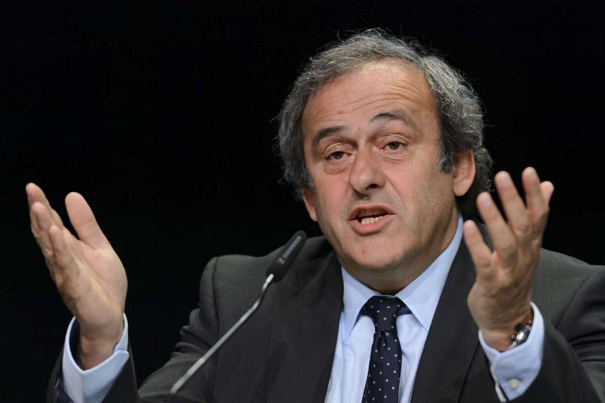 UEFA President Michel Platini gesturing during a press conference prior to the 65th FIFA Congress in Zurich.