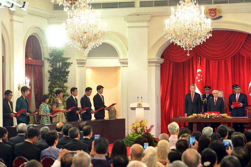 PM Lee Hsien Loong, President Tony Tan and Chief Justice Sundaresh Menon at the swearing-in ceremony. On the left are some of the office-holders.