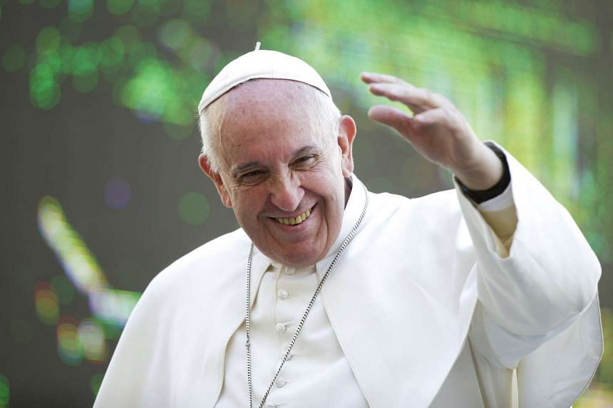 Pope Francis waves as he leads the weekly audience in Saint Peter's square at the Vatican, September 30, 2015.