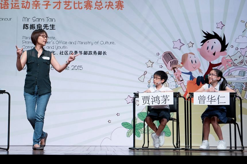 Ms Hazel Chong, her son Li Yu and daughter Kai Han performing at the 2015 in Speak Mandarin Campaign Parent-Child Talent Competition.The nationwide competition, in its third edition, is meant for parents to bond with their children while learning Ma