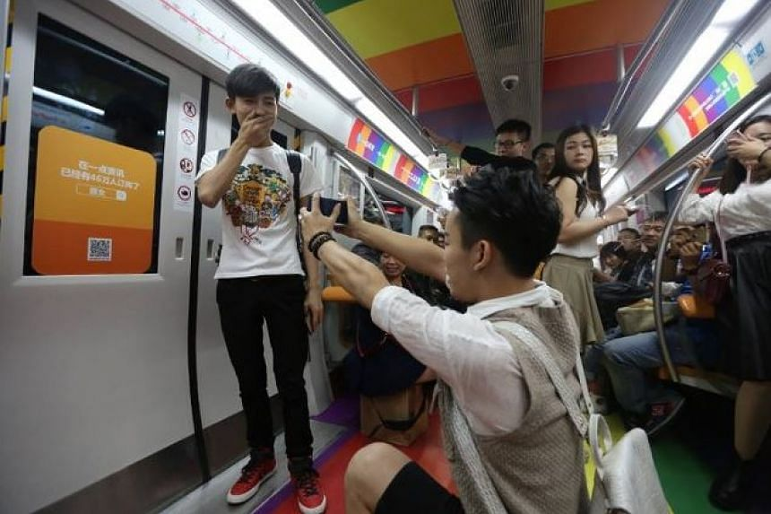 The gay marriage proposal taking place in a rainbow-decorated subway train in Beijing.