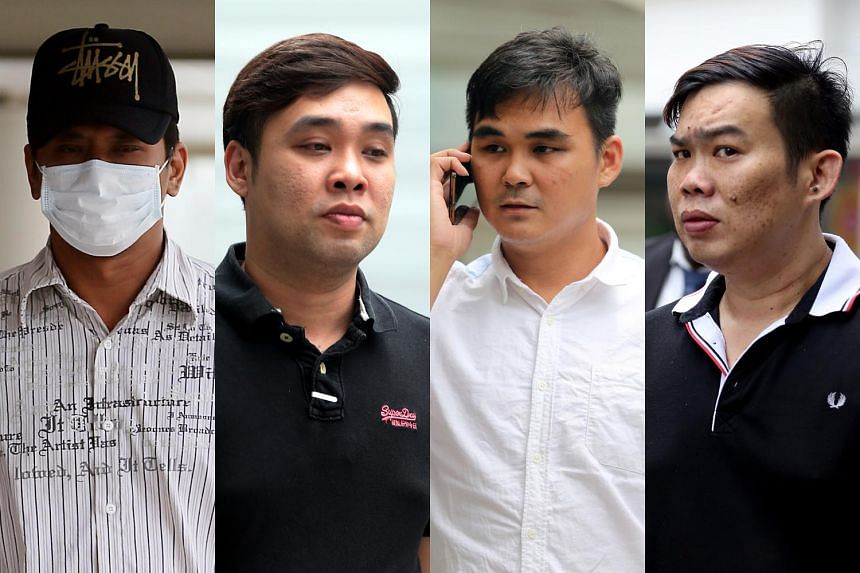 (From left) Koh Guan Seng, Kam Kok Keong,  Lim Hong Ching and Kelvin Lim Zhi Wei admitted to conspiring to cheat customers. Their alleged accomplice, Jover Chew Chiew Loon, owner of the now-defunct shop, will have his case mentioned on Oct 28.