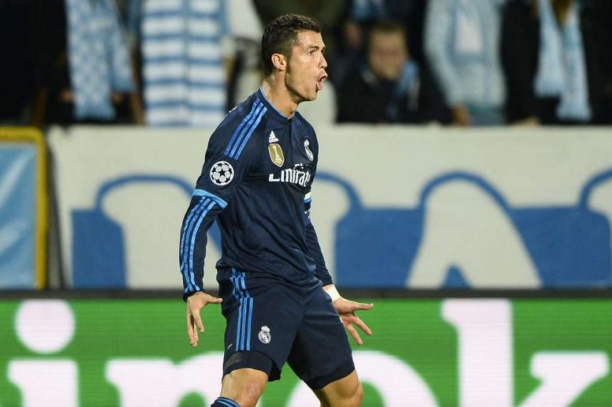 Real Madrid's Cristiano Ronaldo celebrating the opening goal – his 500th career strike – against Malmo during their Champions League Group A match.