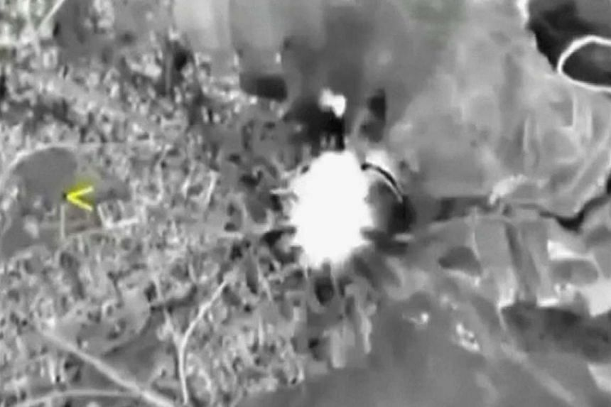 A video frame grab shows Russian jets hitting a target in Syria.