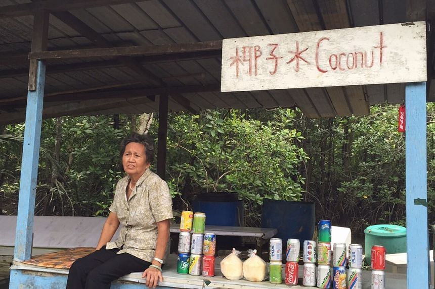 Drinks seller Madam Wang Xiao San, 76, at the drink stall her late husband built.