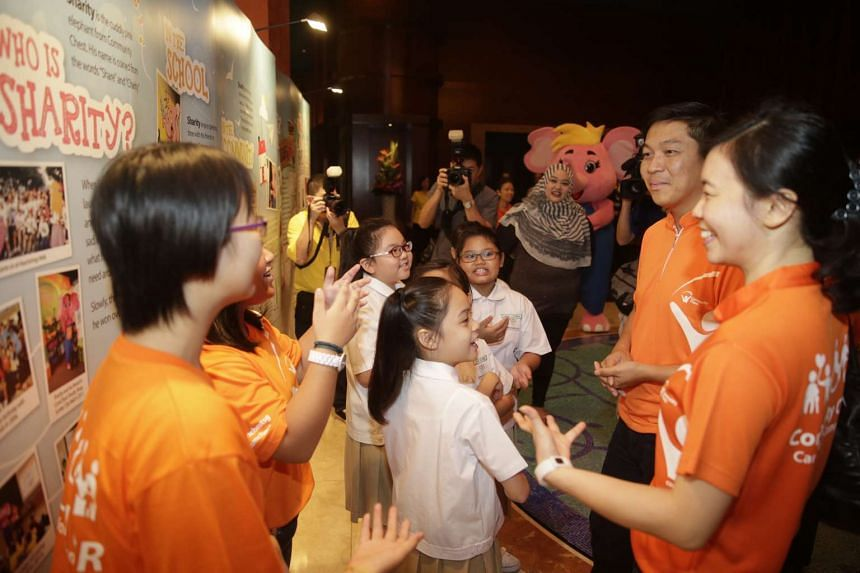 Minister for Social and Family Development Tan Chuan-Jin touring the exhibition at the first Sharity Day created by Community Chest and Resorts World Sentosa and celebrated with a musical at the Resorts World Theatre on Oct 3, 2015.