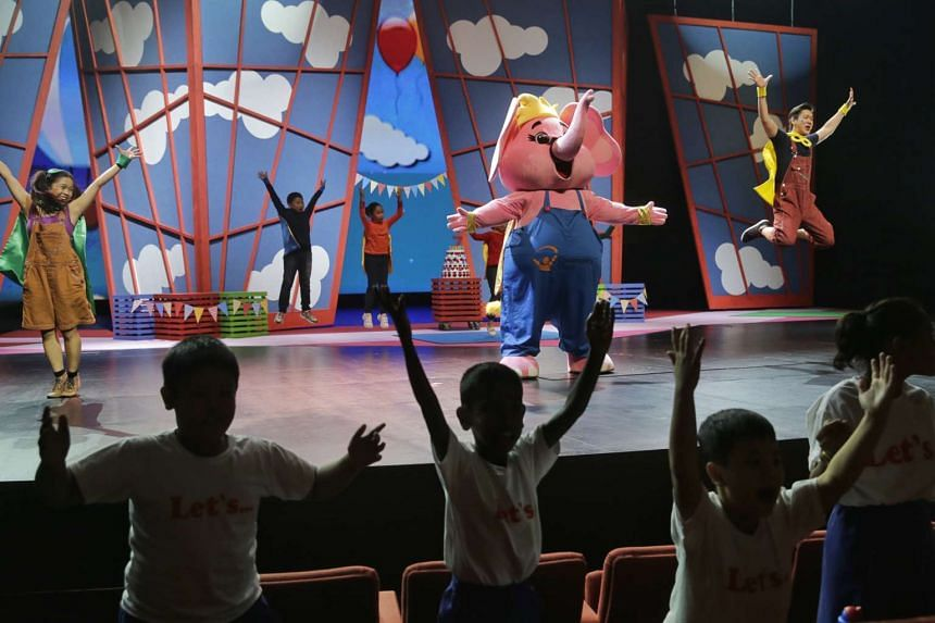 Students (silhouetted) from Grace Orchard School dancing along with Sharity and peformers on stage during the mascot's musical debut at the Resorts World Theatre on Oct 3, 2015.