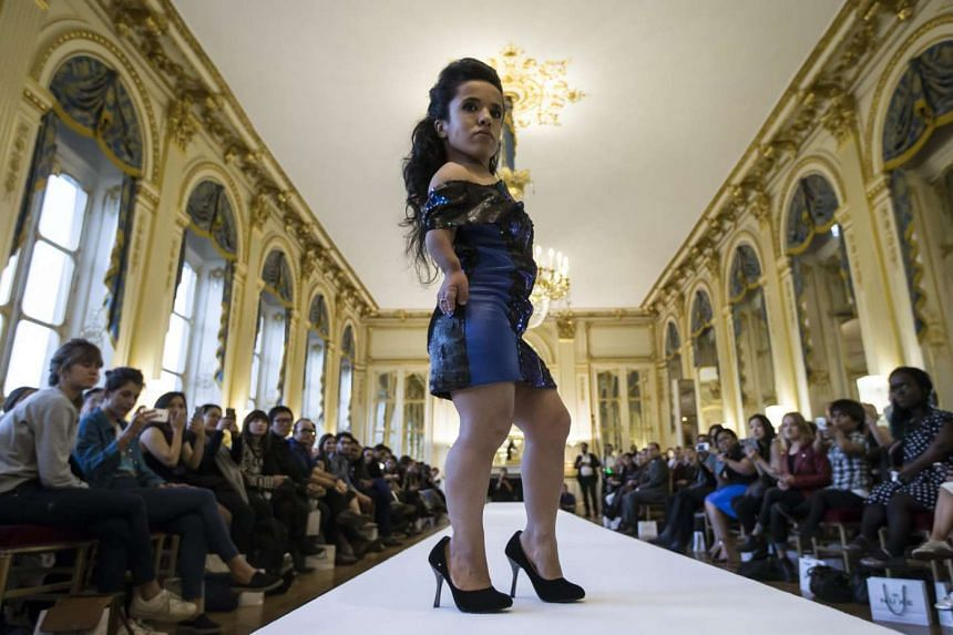 A model presents a creation during the National Dwarf Fashion Show held at the French ministry of Culture in Paris, France on Oct 02, 2015.
