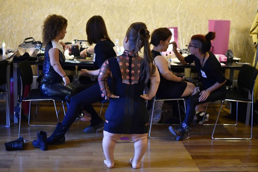 Models get ready prior to the National Dwarf Fashion Show on Oct 2, 2015 during the in Paris.