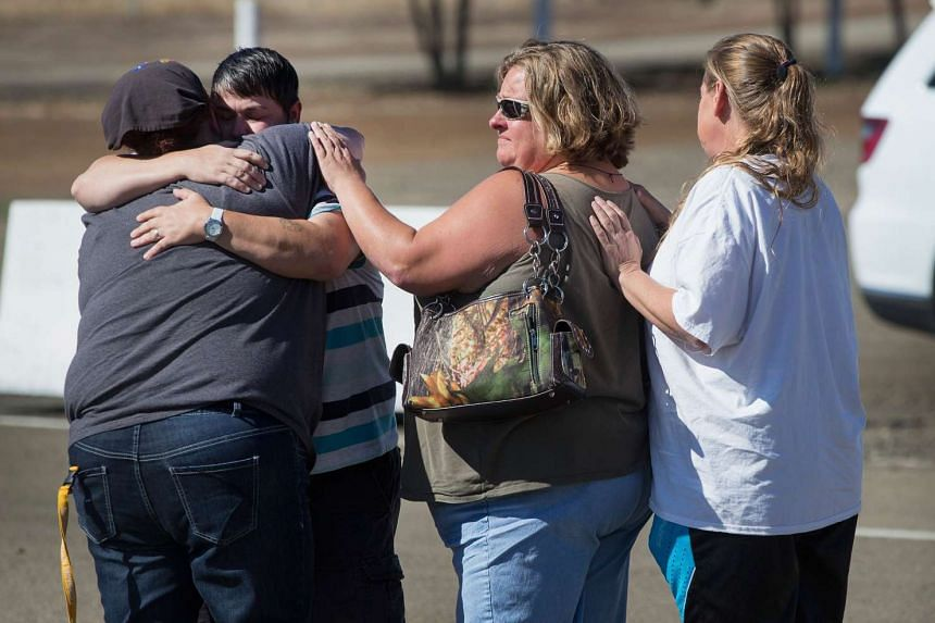 Students and staff of Umpqua Community College arrive at the Douglas County Fairgrounds Complex where they were offered grief counselling and a bus ride back to campus to pick up their possessions and vehicles on Oct 2, 2015 in Roseburg, Oregon.