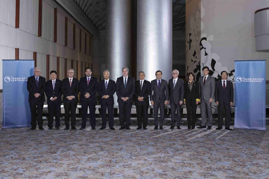"Trade ministers from a dozen Pacific nations in Trans-Pacific Partnership Ministers meeting post in TPP Ministers ""Family Photo"" in Atlanta, Georgia on Oct 1, 2015."